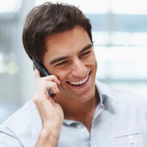 Young handsome guy enjoying a telephonic conversation